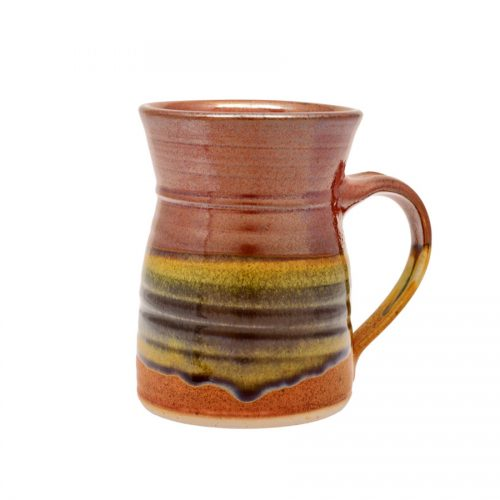 A handmade, red and orange coffee mug with flared sides and a variegated blue band across the surface.