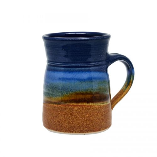 A handmade, blue and orange coffee mug with flared sides and a sky blue band across the surface.