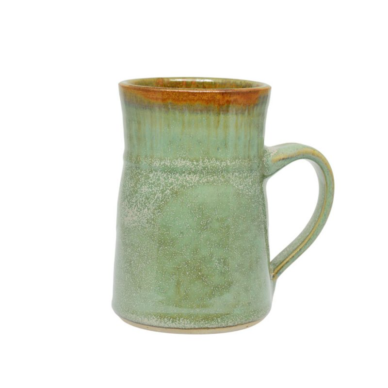 A handmade, frosted mint green coffee mug with flared sides and a bronze colored rim.