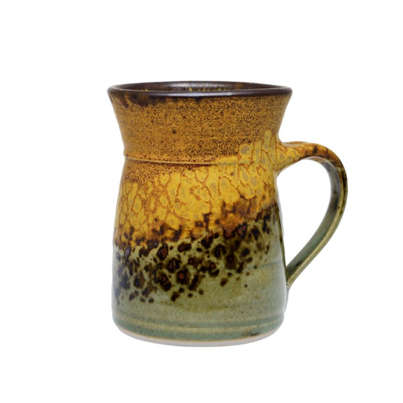A green and coffee mug with flared sides and a dark brown rim, featuring a black and gold animal print band across the surface.