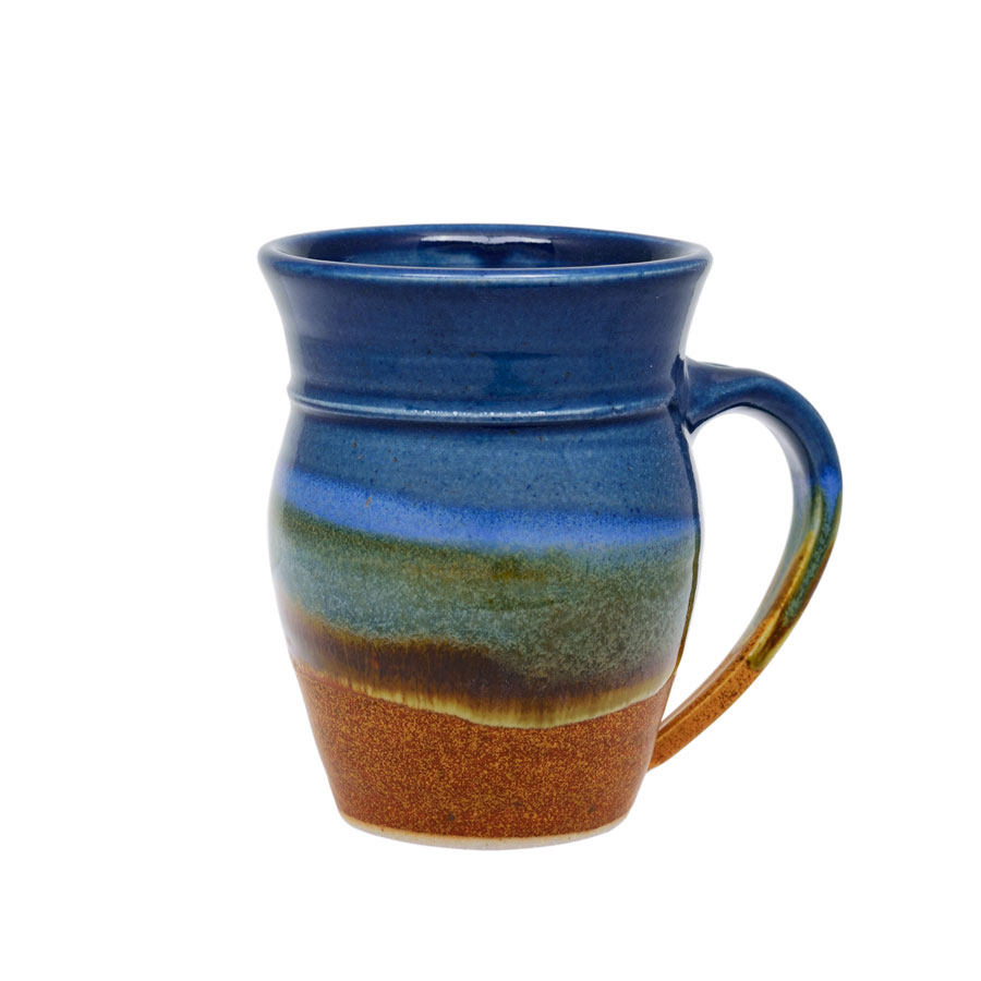 A handmade, blue and sandy brown coffee mug with rounded sides and a sky blue band across the surface.