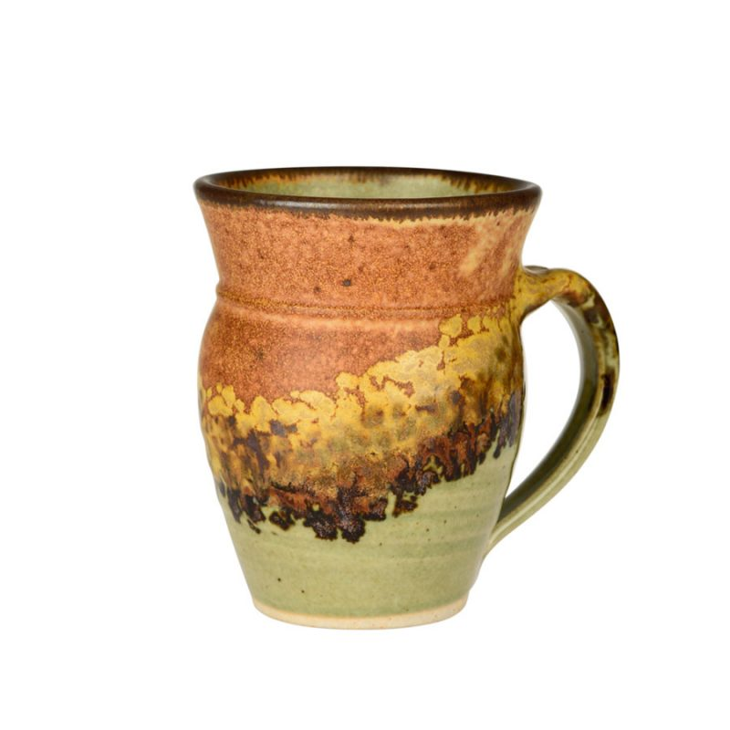 A handmade, green and sandy brown coffee mug with rounded sides and a dark brown rim, featuring a black and gold animal print band across the surface.