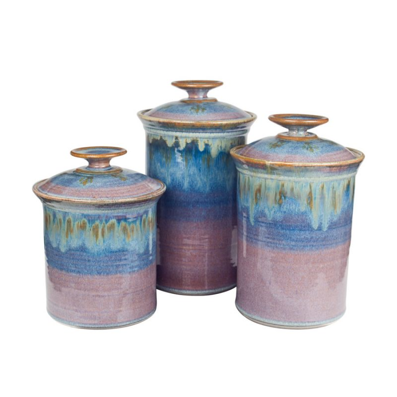 a set of blue lidded canisters