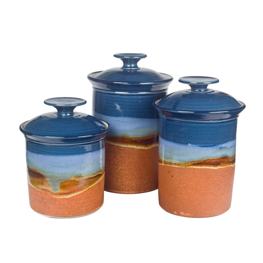 a set of blue and sandy brown lidded canisters
