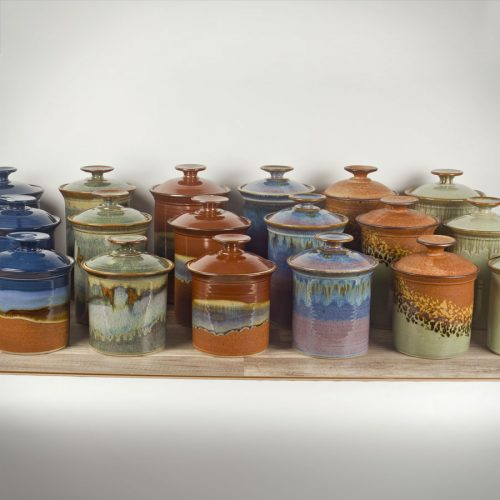 6 3-piece canister sets in different patterns.