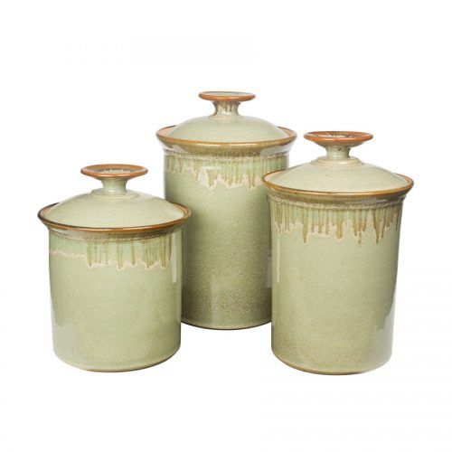 a set of mint green lidded canisters