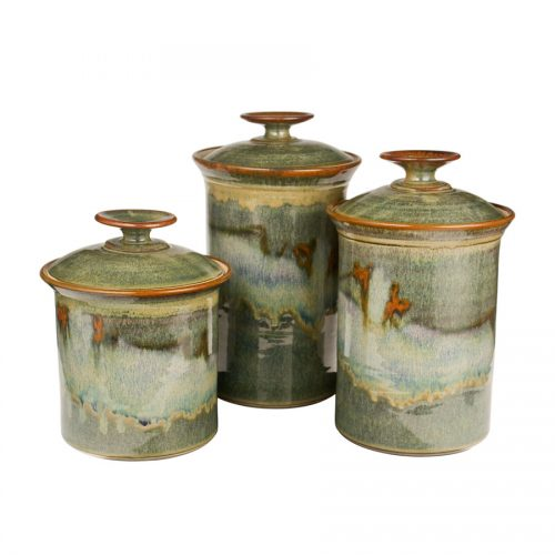 a set of green lidded canisters