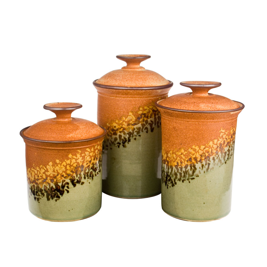 a set of green and sandy brown lidded canisters