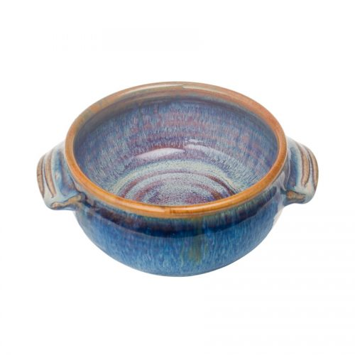 a small, handmade, variegated blue soup bowl with straight sides, handles, and a bronze colored rim.