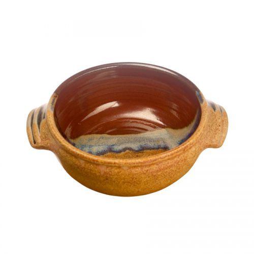 a small, handmade, red and orange soup bowl with straight sides, handles, and a variegated blue band across the surface.