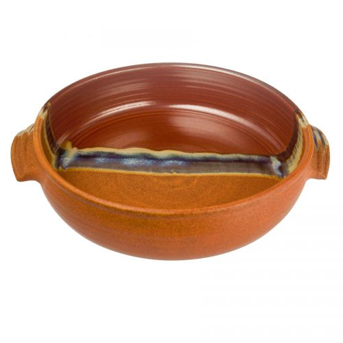 A shallow, handmade baking dish with handles for pulling out of the oven. The pottery is half red, half orange.