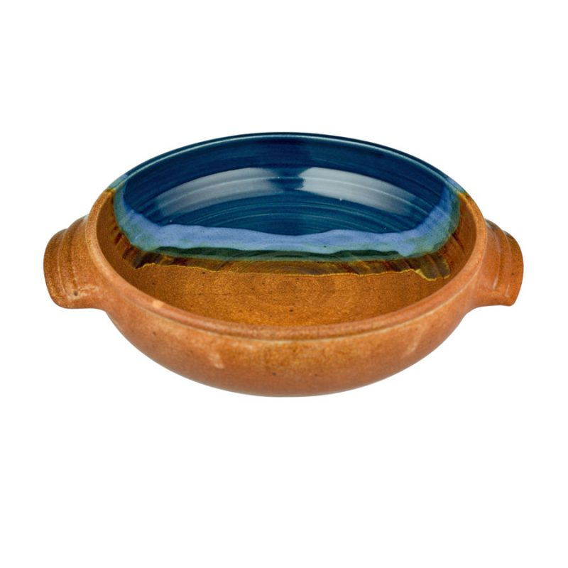 A shallow, handmade baking dish with handles for pulling out of the oven. The pottery is half blue, half orange.