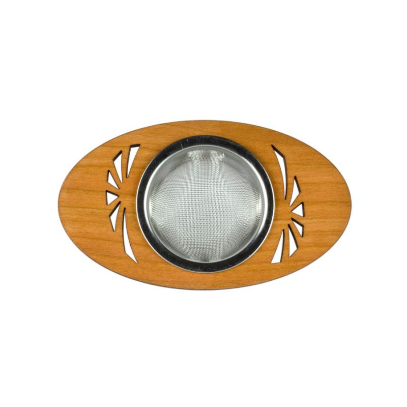 A metal tea strainer for loose leaf tea that sits in wooden oval disc for setting on top of a mug. An abstract sunrise design is cut out of the wood on either side of the metal strainer.