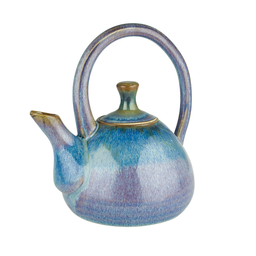A variegated blue teapot with a large looping handle and a short spout.