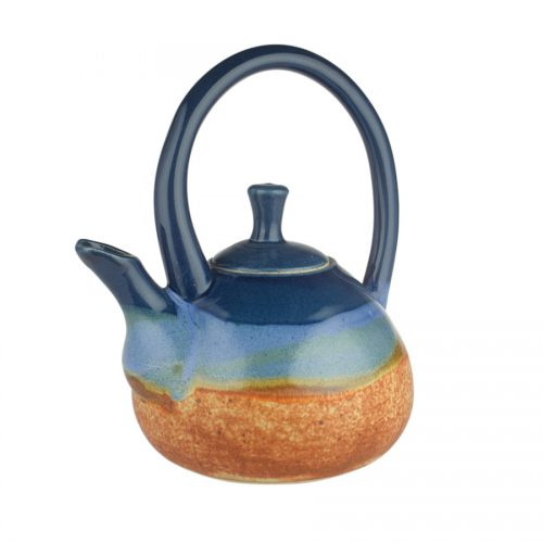 A blue and orange teapot with a large looping handle on top and a short spout.