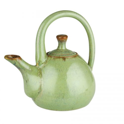 a mint green teapot with a large looping handle on top, and a short spout.