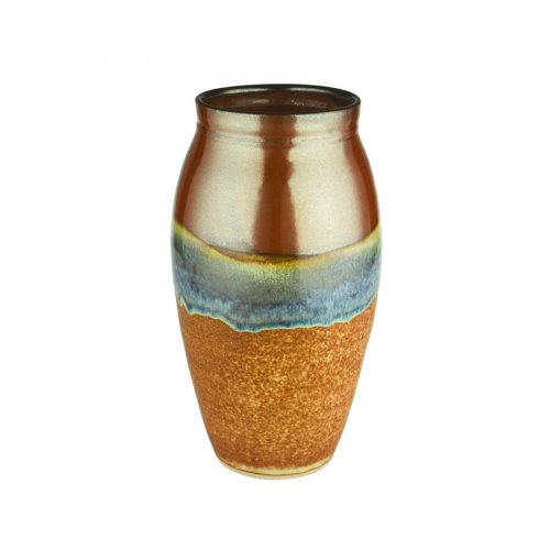 A tall, cylindrical, handmade vase for holding flowers. The pottery is red on top, and orange on the bottom.