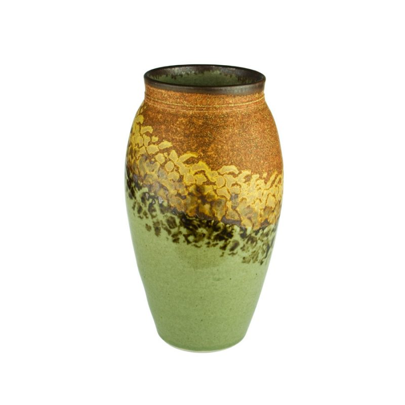 A tall, cylindrical, handmade vase for holding flowers. The pottery is orange on top, and green on the bottom, with a black and gold animal print across the middle.