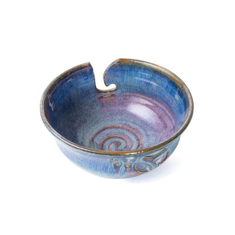 a top view of a blue handmade ceramic yarn bowl.